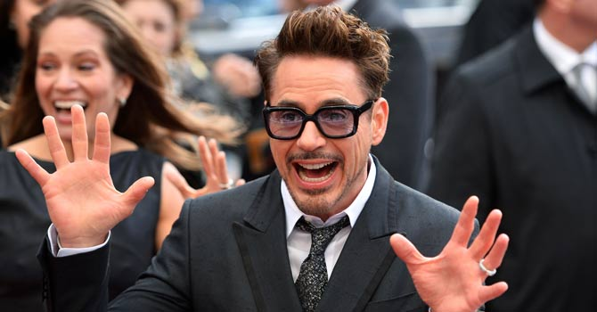 "US actor Robert Downey Jr. poses for picture on the red carpet as he arrives for the premier of his latest film ""Iron Man 3"" in Leicester Square in central London in this file photo. — AFP Photo"