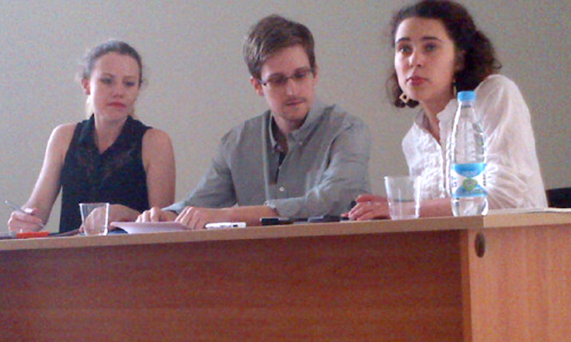 Picture released by Human Rights Watch shows US National Security Agency (NSA) fugitive leaker Edward Snowden (C) during a meeting with rights activists, with among them Sarah Harrison of WikiLeaks (L), at Moscow's Sheremetyevo airport, on July 12, 2013.  Fugitive US intelligence leaker Edward Snowden on Friday told a group of activists airport that he wanted to claim asylum in Russia because he is unable to fly on anywhere else. — AFP Photo