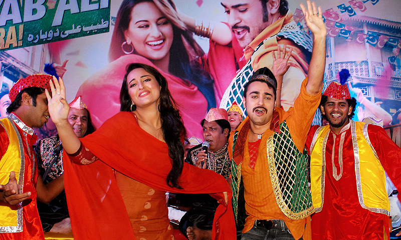 "In this photograph taken on June 28, 2013 Indian Bollywood actress Sonakshi Sinha (L) and actor Imraan Khan pose during the promotion of the forthcoming Hindi Film ""Once Upon a Time in Mumbaai 2"" in Mumbai.   A string of Bollywood releases this year show the Indian film industry's ongoing fascination with Mumbai's underworld, following a murky history of links between the mafia and the movie business.—Photo by AFP"