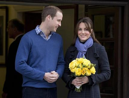 n this Thursday, Dec. 6, 2012 file photo Britain's Prince William stands next to his wife Kate, Duchess of Cambridge as she leaves the King Edward VII hospital in central London. — AP Photo