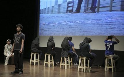 "In this undated photo, Iranian actors and actresses perform a scene from ""The Blue Feeling of Death,'' in Arasbaran Cultural Center in Tehran, Iran. The production, translated from Farsi as ""The Blue Feeling of Death,"" opened in June 2013, as a showcase of activist art against Iran's legal codes that allow death sentences for children — who then wait until their 18th birthday for possible execution. — AP Photo"