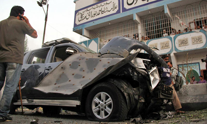 Photo shows Metropolitan Commissioner Matanat Ali Khan's vehicle damaged in a bomb attack in Karachi on July 20, 2013.—Photo by Online