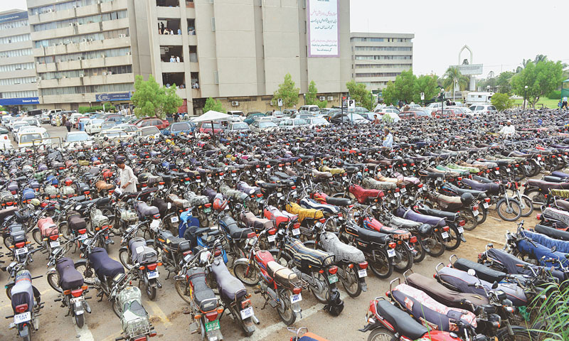 A large number of motorbikes parked at the Civic Centre where the headquarters of the Karachi Metropolitan Corporation and offices of other civic agencies are located. — Photo by Fahim Siddiqi/ White Star