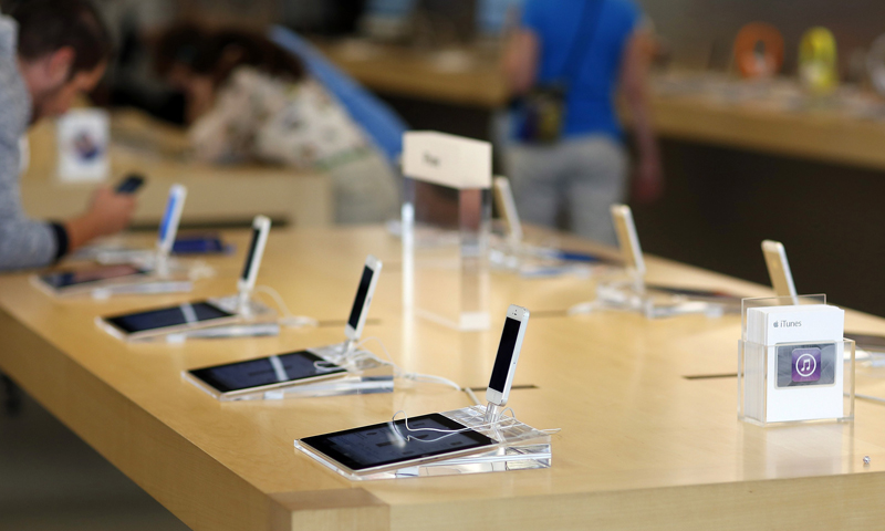 iPhone 5 models are pictured on display at an Apple Store in Pasadena, California July 22, 2013. — Reuters Photo
