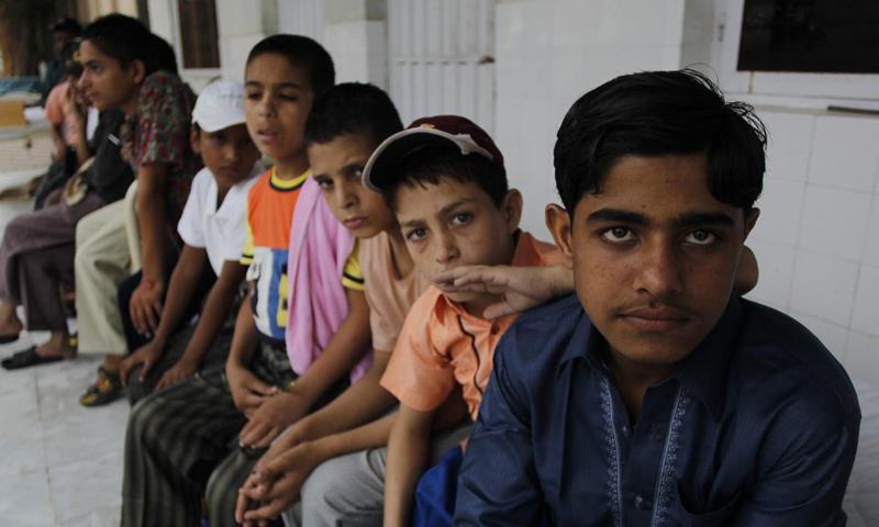 Runaway or lost children from cities wait at the Islamabad Edhi centre  to reach their homes and families. — AP Photo.