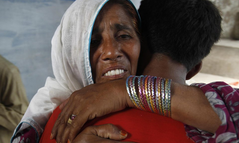 Taj bibi reunites with her grandchild, Zeeshan Ali, after six years. — AP photo.