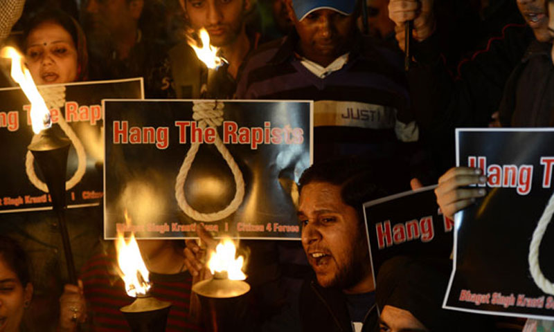 Indian students and activists shout slogans as they carry torches at India Gate during a protest following the gang-rape of a student in New Delhi, Dec 19, 2012. — File Photo by AFP