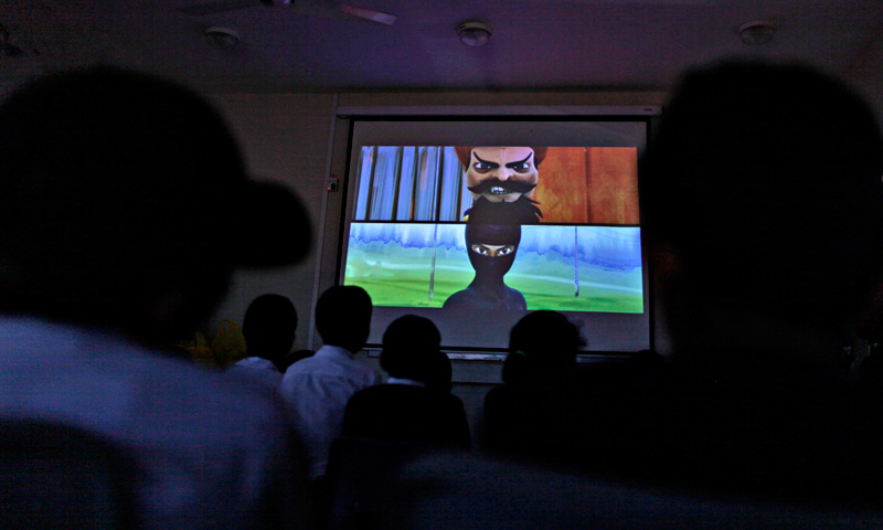 Orphaned children watch an early screening of the first episode of the animates Burka Avenger series, at an orphanage on the outskirts of Islamabad. — AP Photo