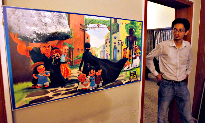 A man looks at a poster of the animated Burka Avenger series on display at an office in Islamabad, Wednesday, July 24, 2014. — AP Photo