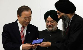 Mr. Tuli with Ban Ki Moon holding Aakash.
