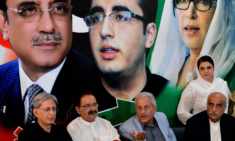 Pakistan People's Party (PPP) Senator Raza Rabbani (2nd R, seated), a candidate for the country's upcoming presidential election, speaks while flanked by party leaders Ameen Fahim (2nd L), Aitzaz Ahsan (L) and Khurseed Shah (R) during a news conference in Islamabad on July 26, 2013. — Photo by AFP
