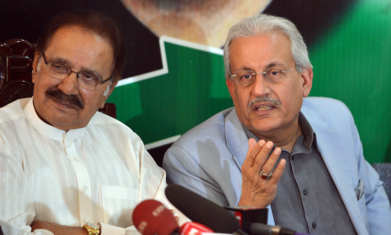 Opposition Pakistan People's Party (PPP) Senator Raza Rabbani (R), a candidate for the country's upcoming presidential election, speaks while party leader Ameen Fahim (L) looks on during a news conference in Islamabad on July 26, 2013.  — Photo by AFP