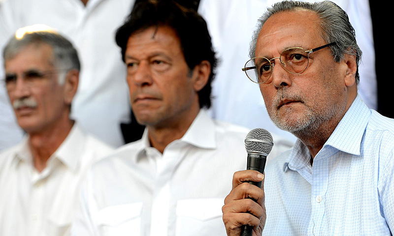Wajihuddin Ahmed (R), a presidential candidate of PTI addresses a press conference along with party chairman, Imran Khan (C). -Photo by AFP