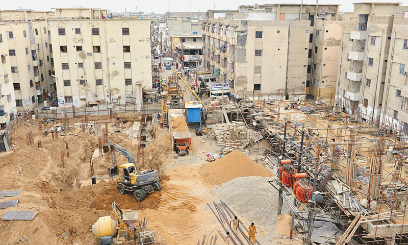 Work on the construction of flats near Abbas Town is under way. — Fahim Siddiqi / White Star