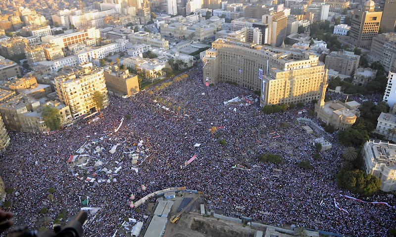 In this Friday, July 26, 2013, photo released on Saturday, July 27, by Egyptian army, opponents of Egypt's ousted President Mohammed Morsi demonstrate at Tahrir Square in Cairo, Egypt.  (AP Photo/Hossam Diab, Egyptian army)