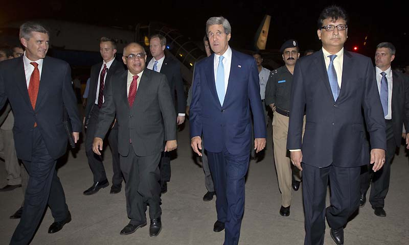 US Secretary of State John Kerry walks with unidentified Pakistani officials and US Ambassador to Pakistan Richard Olson, left, upon his arrival in Islamabad, Pakistan, Wednesday, July 31, 2013.  — Photo by AP