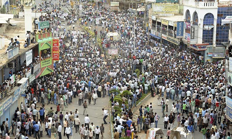 Anti Telanga protestors gather for a protest after India's ruling coalition Tuesday endorsed the creation of a new state 'Telangana' in Ananthapur,Andhra Pradesh state, India, Wednesday, July 31, 2013. Telangana would become India's 29th state. — Photo by AP