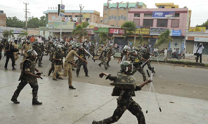 Indian policemen throw stones at anti Telangana protestors in Ananthapur, Andhra Pradesh state, India, Wednesday, July 31, 2013. — Photo by AP