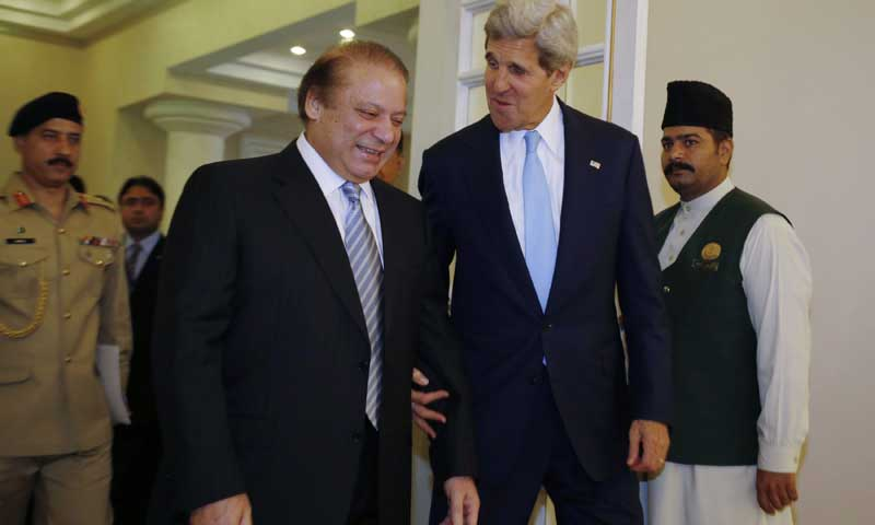 US Secretary of State John Kerry (2R) walks into a meeting with Prime Minister Nawaz Sharif in Islamabad on August 1, 2013. — Photo by AFP