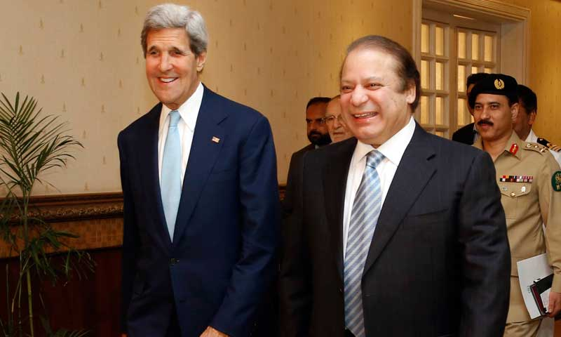 US Secretary of State John Kerry, left, walks into a meeting with Prime Minister Nawaz Sharif in Islamabad, August 1, 2013. — Photo by AP