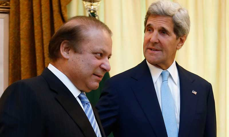 US Secretary of State John Kerry (R) walks into a meeting with Prime Minister Nawaz Sharif in Islamabad, August 1, 2013, in front of a portrait of Mohammad Ali Jinnah. — Photo by Reuters