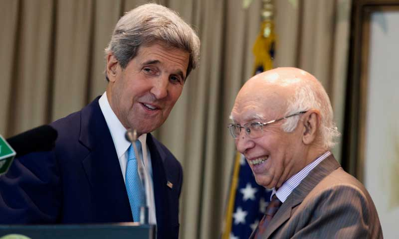 Sartaj Aziz, right, adviser on national security and foreign affairs, interacts with US Secretary of State John Kerry after their press conference in Islamabad, August 1, 2013. — Photo by AP