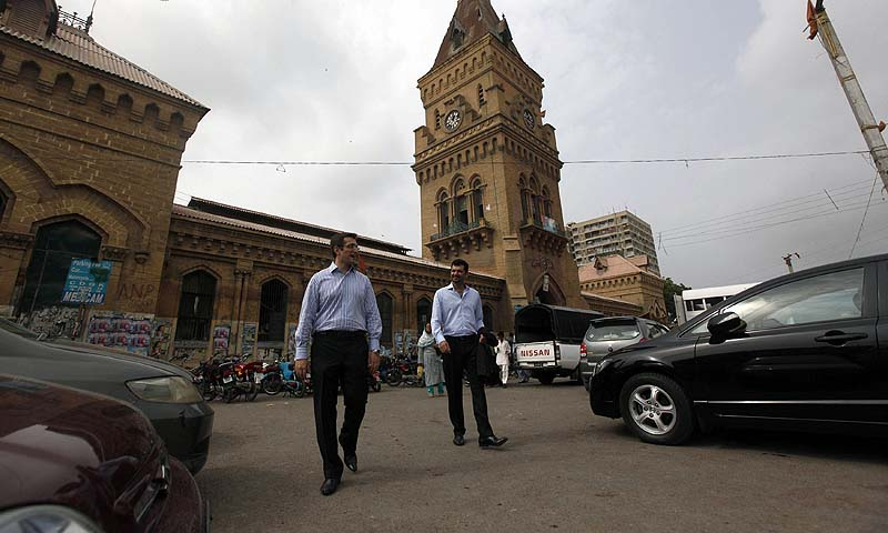 Isfandiyar Shaheen (L) and Shaharyar Ahmed, Principals and Co-Heads of Growth Equity for Cyan Capital, walk during their visit at Karachi's Empress Market August 1, 2013. — Photo by Reuters