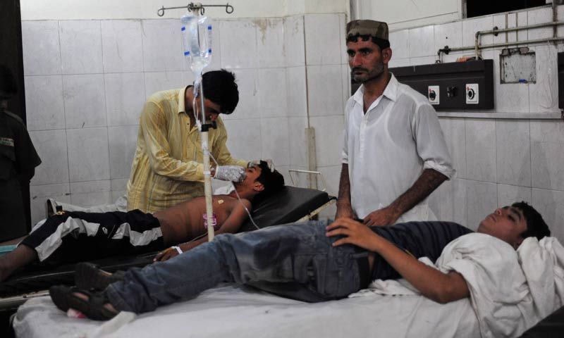 Paramedics treats an injured blast victim at a hospital in Karachi. -AFP Photo