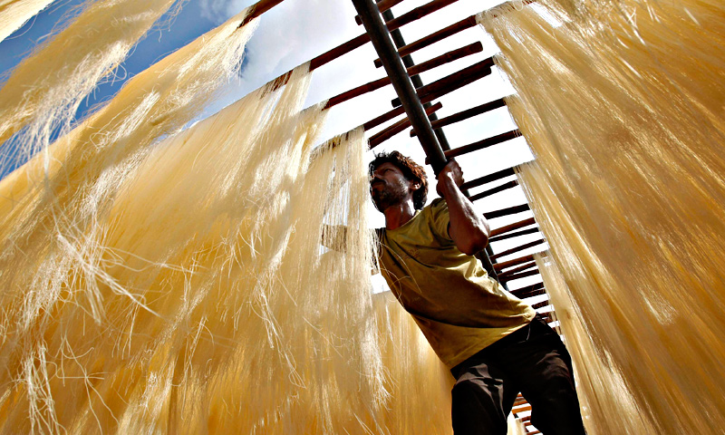 A worker dries vermicelli, a specialty eaten during the Muslim holy month of Ramadan. — Reuters Photo