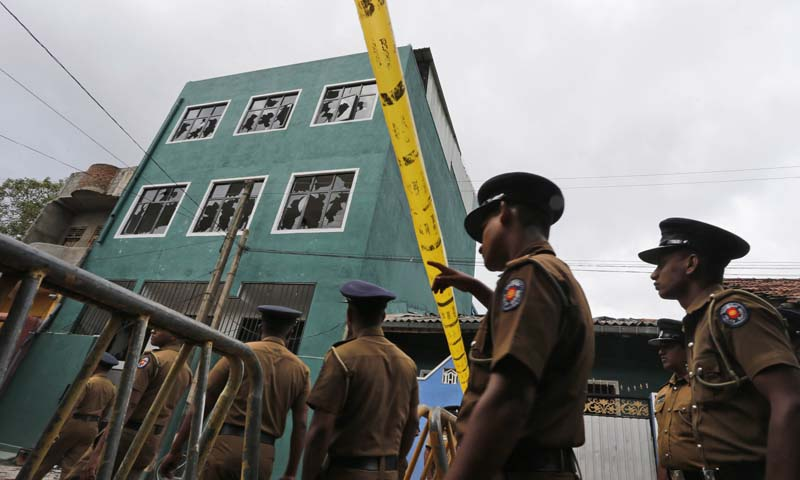 Sri Lankan police officers patrol outside an attacked mosque in Colombo, Sri Lanka, Sunday, Aug. 11, 2013.   — Photo by AP