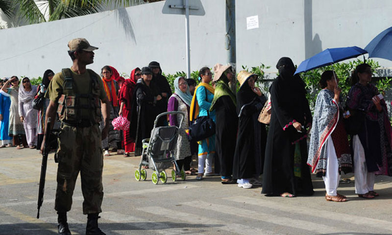 A pakistani army soldier stands guard at a polling station. — File photo