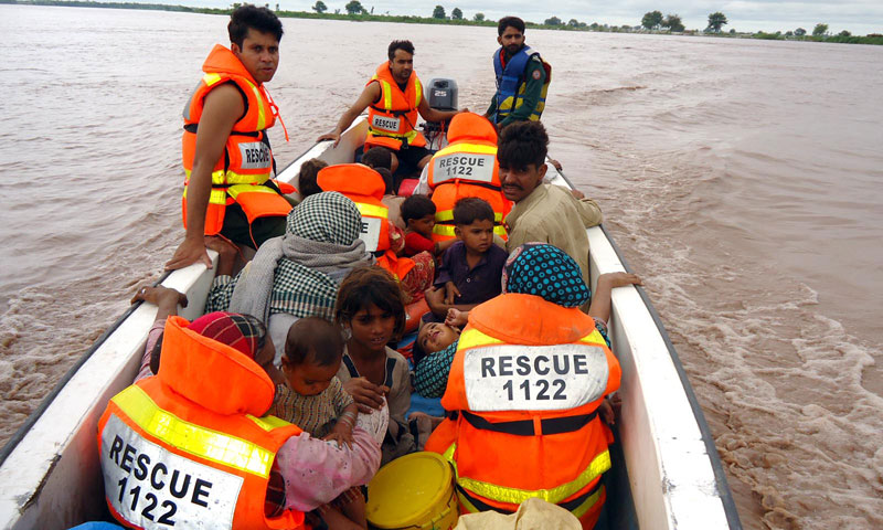 Rescue 1122 workers buys in rescue operation in flood affected areas at Village Jokalian near Head Qadir Abad. — Photo by INP