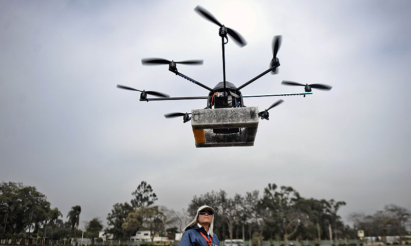 A man controls a drone (unmanned vehicle) in Lima.