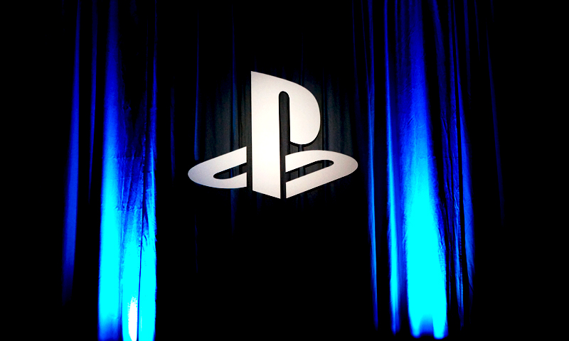 Image shows Sony's PlayStation logo in front of a dropped curtain at Gamescom 2013 in Cologne, Germany. — Wajhi Jafri/Bilal Brohi Photo