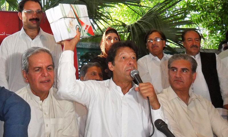 Pakistan Tehrik-i-Insaf (PTI) chief Imran Khan unveils white paper on poll rigging during a press conference in Islamabad on Wednesday. – Photo by Online