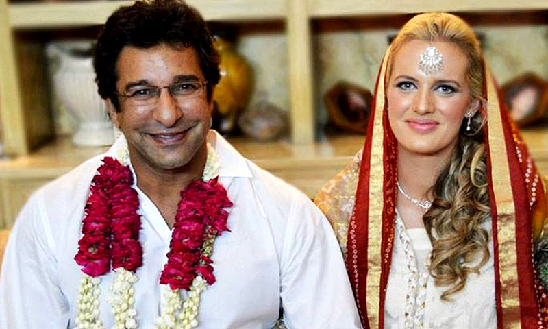This handout photograph provided courtesy of Wasim Akram on August 21, 2013 shows former Pakistani cricket captain Wasim Akram (L) posing for a photograph with his Australian bride Shaniera Thompson during their wedding ceremony in Lahore on August 12, 2013. -Photo by AFP