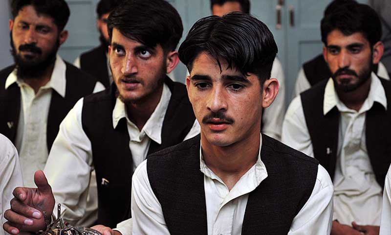 Pakistani youths, who worked under the Taliban attend a class at the army-run de-radicalisation centre of Mishal School in Swat. — File photo/AFP