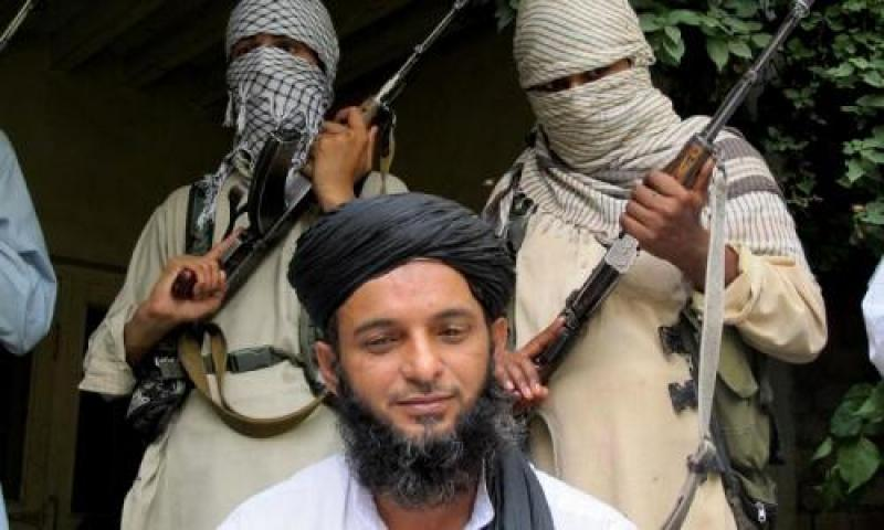 Asmatullah Muawiya, head of the Punjabi Taliban faction, listens to reporters at an undisclosed place in the tribal region of Waziristan. —Photo by AP