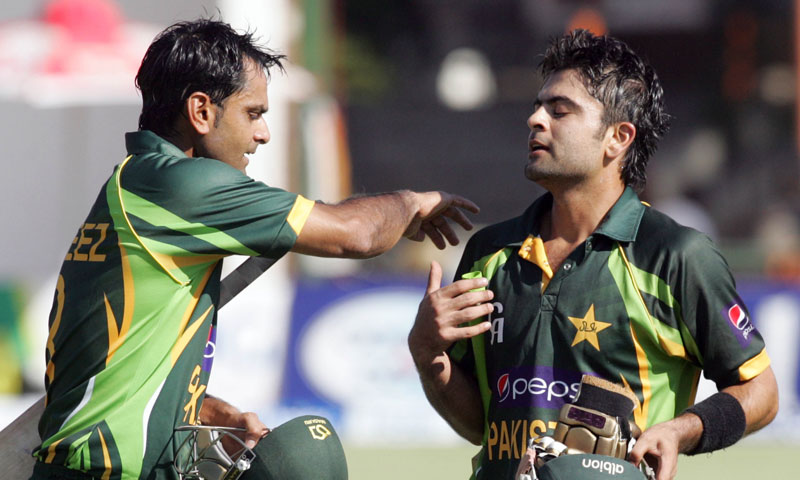 Pakistan's captain Muhammad Hafeez (L) congratulates team mate Ahmed Shehzad (R) on reaching 98 runs during the second and final Twenty20 international between Zimbabwe and Pakistan at the Harare Sports Club on August 24, 2013. – AFP Photo