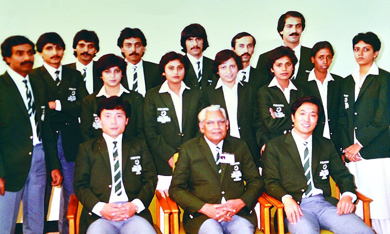 Pakistan team that featured in the 7th Asian Table tennis Championship held at Islamabad in 1984. Team manager Mr Sanaullah is seated in the centre flanked by the Chinese coaches.   — Photo courtesy :Anwer Zuberi collection (reproduced by Fahim Siddiqui/White star)