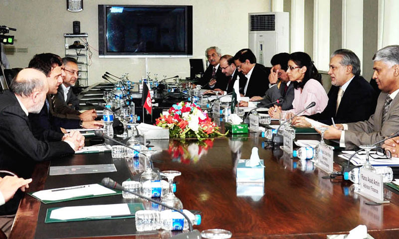 Federal minister for finance senator Mohammad Ishaq Dar in a meeting with Dr. Hazrat Omar Zakhilwal finance minister of Afghanistan in . — INP Photo