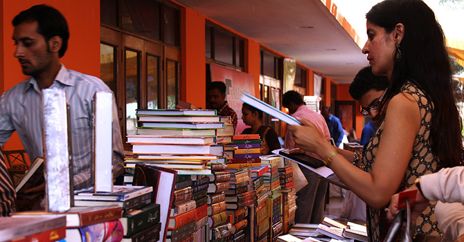 A woman going through books at a stall, Karachi Literature Festival, 2013. - Photo by Shameen Khan/Dawn.com