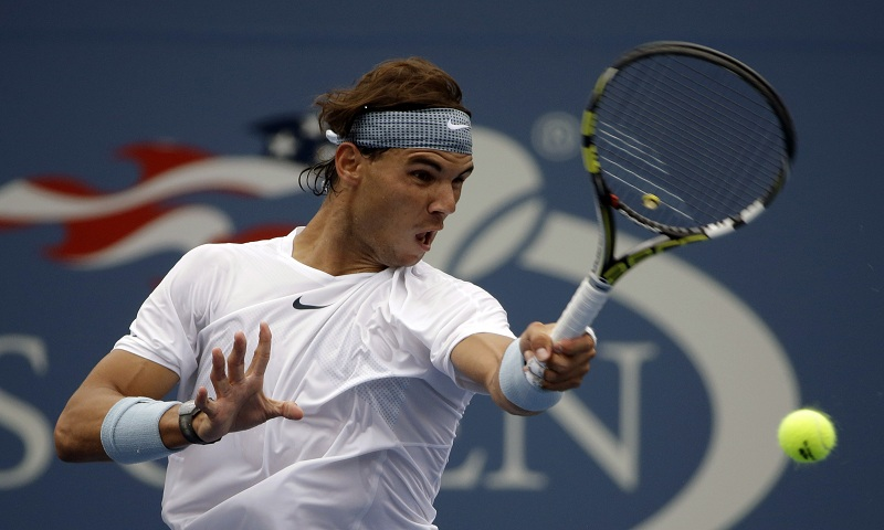 Rafael Nadal, of Spain, returns a shot to Ryan Harrison during the first round of the 2013 U.S. Open tennis tournament Monday, Aug. 26, 2013, in New York. (AP Photo/David Goldman)