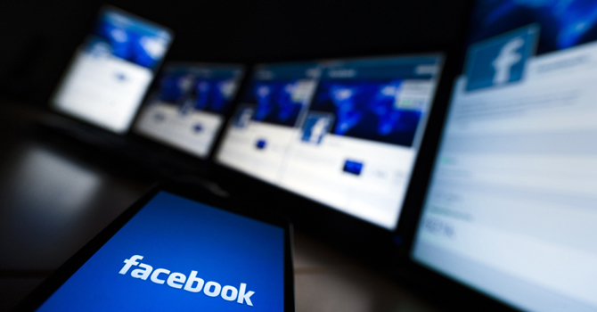 The loading screen of the Facebook application on a mobile phone is seen in this file photo illustration taken in Lavigny May 16, 2012. — Reuters Photo