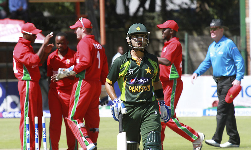 Pakistani batsman Ahmed Shezhad, center, walks off the pitch after being stumped out by Zimbabwean wicketkeeper Brendan Taylor (1) on the first match of a one day international series in Harare, Zimbabwe, Tuesday, Aug. 27, 2013. — Photo by AP
