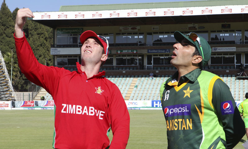 Zimbabwean cricket captain Brendan Taylor, left, tosses a coin next to his Pakistani counterpart Misbah-ul-Haq on the first day of their one day international series in Harare, Tuesday, Aug. 27, 2013. Pakistan is in Zimbabwe for a month-long tour which will see them playing ODIs and Test matches against the hosts. — Photo by AP