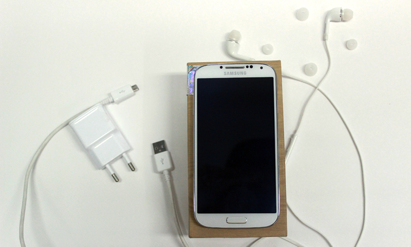 Samsung Galaxy S4 pictured with accessories provided. — Bilal Brohi Photo
