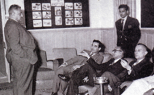 Members of the Muslim League and the Republican Party sitting outside the Constituent Assembly in Karachi just before passing the 1956 Constitution.