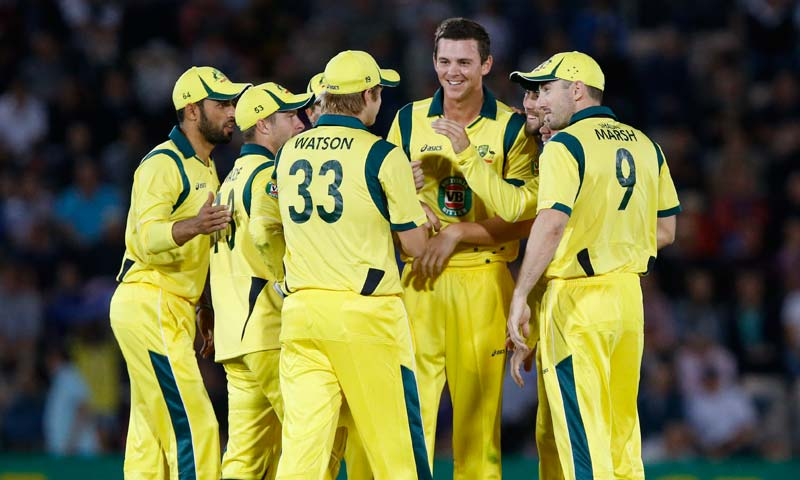 Australia's players celebrate the wicket of England's Luke Wright during their Twenty20 cricket match at The Ageas Bowl cricket ground in Southampton, England. -AP Photo