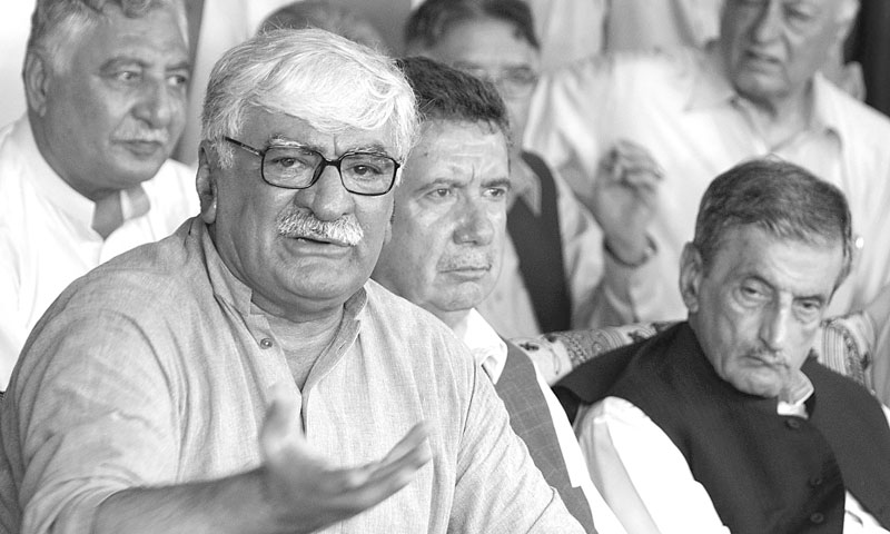 Awami National Party president Asfandyar Wali Khan speaks at a press conference at Wali Bagh, Charsadda, on Saturday. — Photo by Shahbaz Butt/White Star